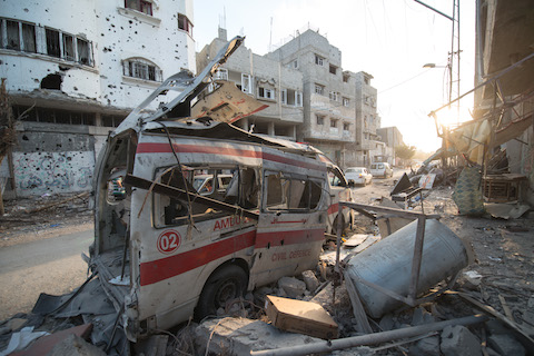 Destroyed_ambulance_in_the_city_of_shijaiyah_in_the_gaza_strip-48036bb6633ff25b8e6f6a265f8fd262-