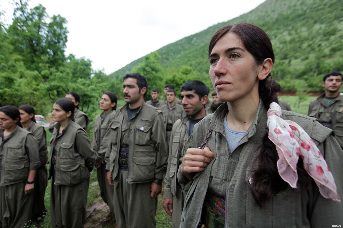 Kurdistan-workers-party-pkk-fighters-stand-in-formation-a3a0571c60f32874a3167661f13a7f9a-