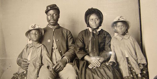 Unidentified_african_american_soldier_in_union_uniform_with_wife_and_two_daughters-