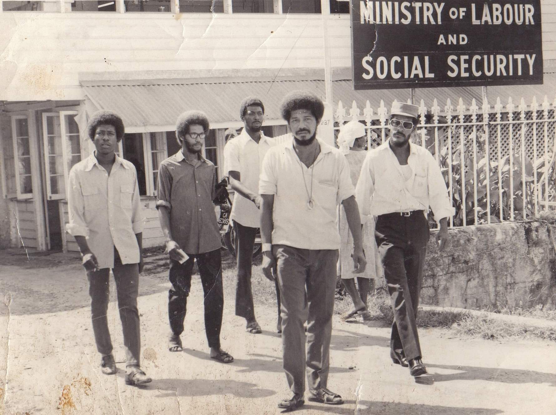 Walter_rodney_and_w.p.a_members_exit_the_ministry_of_labour___social_security__guyana_-_1970s.-