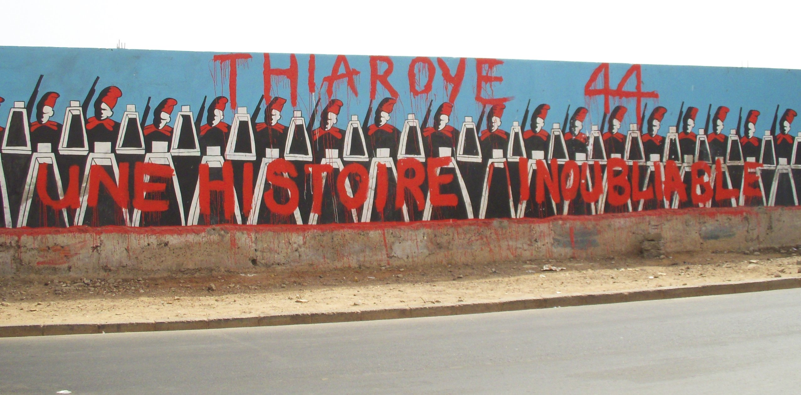 A_mural_in_dakar_senegal_commemerating_the_thiaroye_massacre_of_1944_-_erica_kowal-