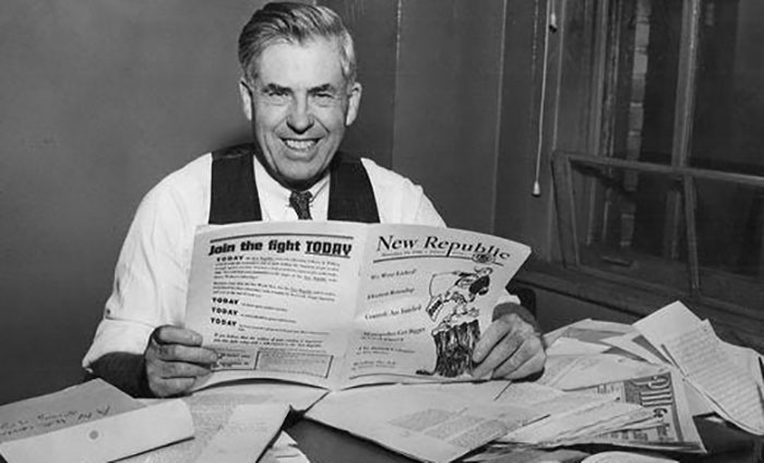 Henry_wallace_reading_paper-